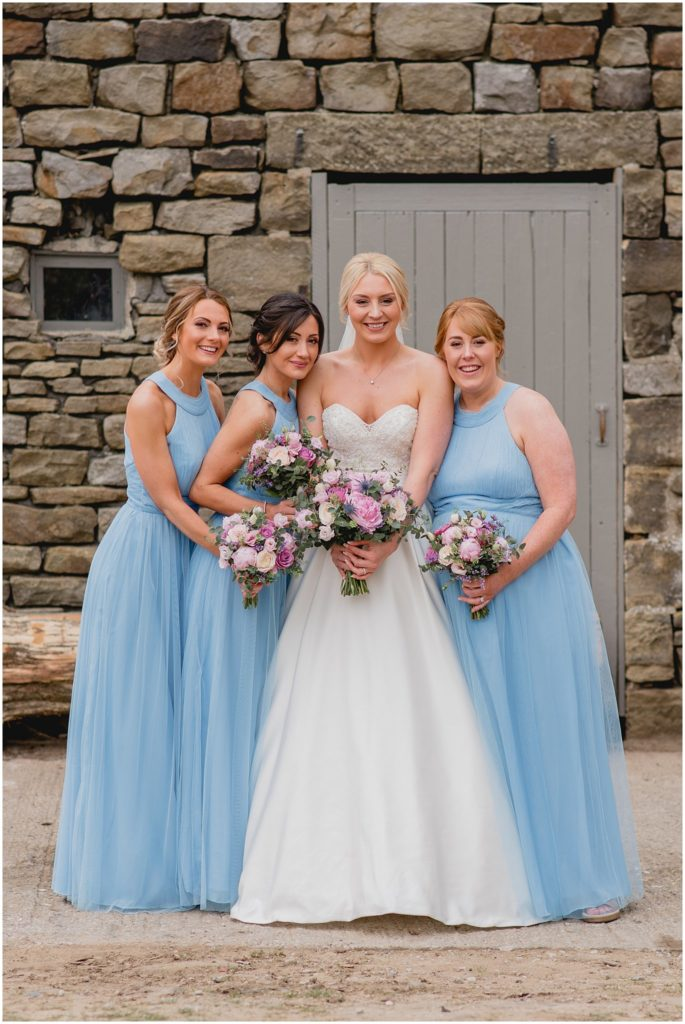 Alt: Barn wedding group shot